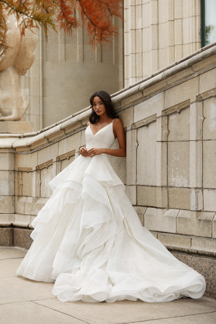 Ivory sparkle bias lined ball gown, V-neckline with jeweled strap at open back, angled cummerbund at natural waist, asymmetrical waterfall skirt layered with tulle and horsehair trim, chapel train.