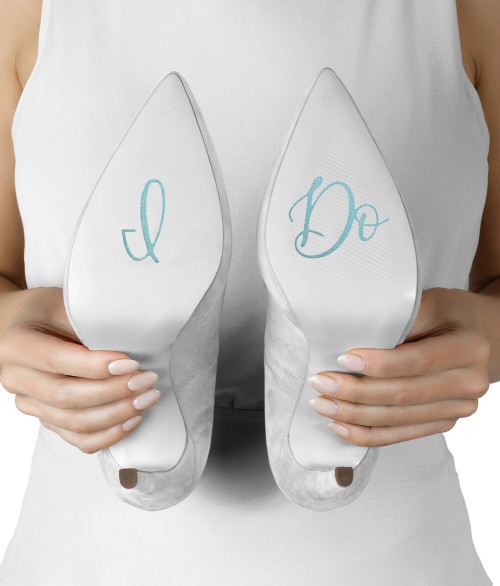 Embellish the bottom of the Brides shoe with these I Do stickers! Done in a pretty turquoise color, these stickers will serve as the Brides Something Blue. Stickers make for a fun detail when the Bride is kneeling at her ceremony or kicks her heels up for a picture!