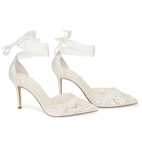 Silky ivory ribbons caress the leg, reminiscent of a traditional ballet slipper on these wedding heels with pearls. Delicately loop the ribbons around your ankle and knot the ends into a trim bow. Only the most discerning observer will spot the pearl beads incorporated into the floral lace design.