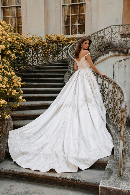 This off-shoulder beaded satin ballgown is a dream come true for the bride who always dreamed of being a princess.