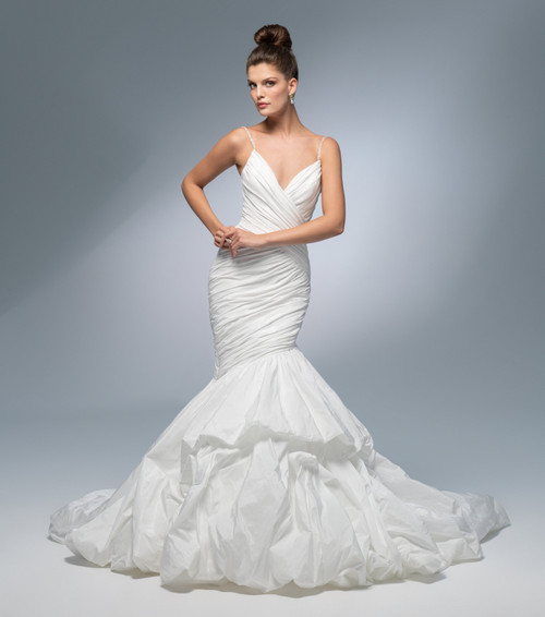 Cloud white taffeta fit to flair gown, sweetheart neckline with beaded shoulder strap, asymmetrical ruched bodice, elongated waistline, layered skirt with bubble hem, chapel train.