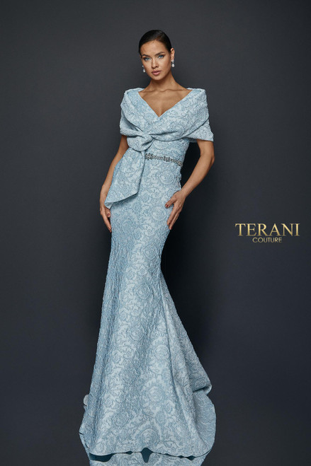 Draped off shoulder stole reveals a simple gown with waist beads all in stretch Jacquard.