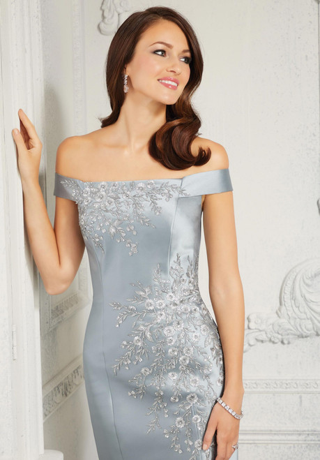 Gorgeous evening dress featuring beautiful crystal beaded, metallic embroidered appliqus on a sleek Larissa satin fit and flare.