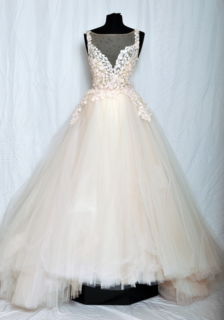 Petal embroidered tulle ball gown, sheer net at neckline, sweetheart bodice accented with chiffon petals cascading on skirt, natural waist, chapel train.