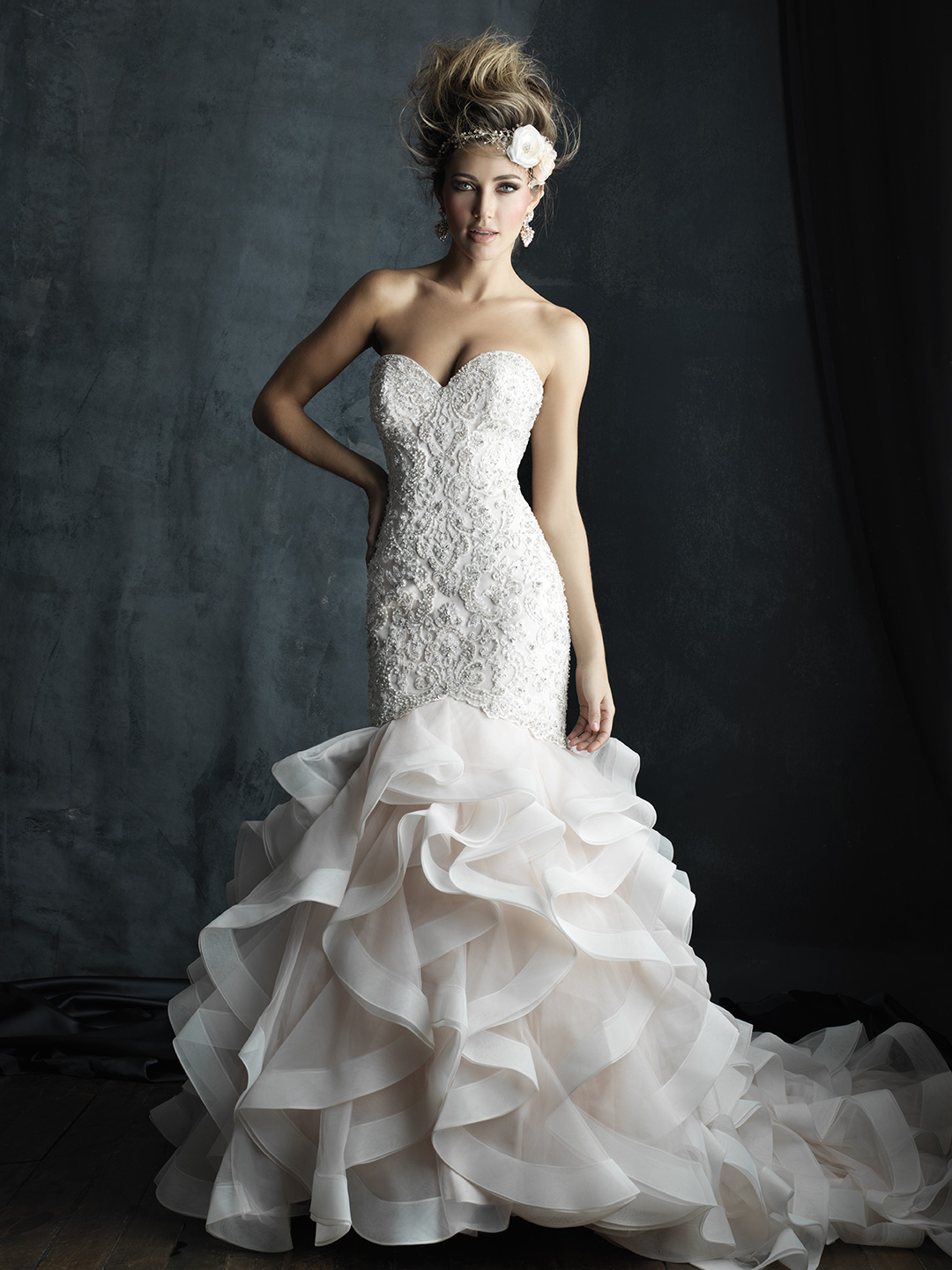 This ruffled gown hugs your curves and sparkles with intricate Swarovski beadwork.