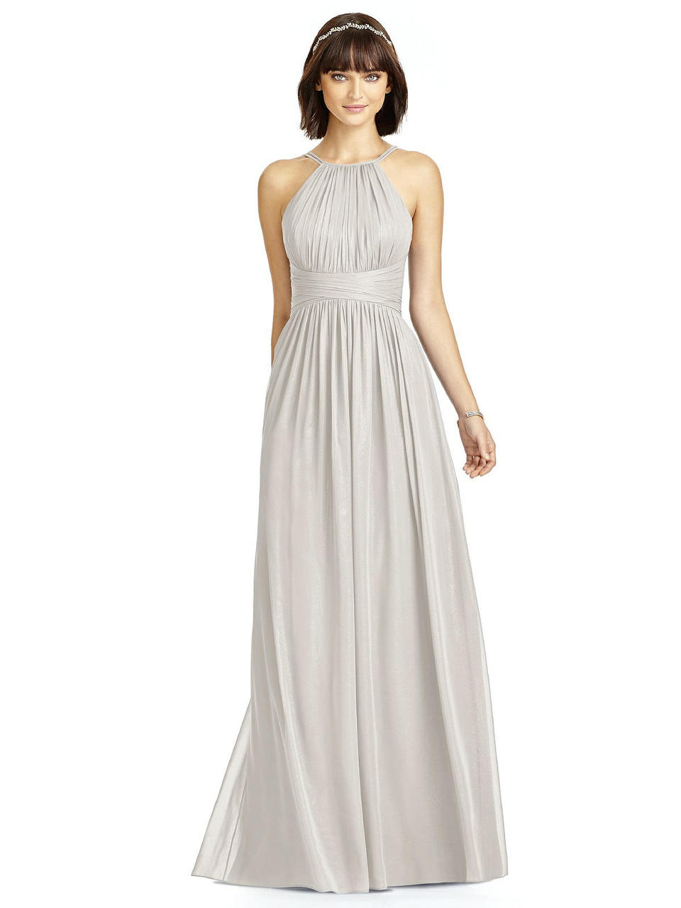 Full length lux shimmer dress w/ modified halter neckline and open back. Spaghetti straps from halter create v-detail at back. Shirred bodice and midriff. Shirred skirt.