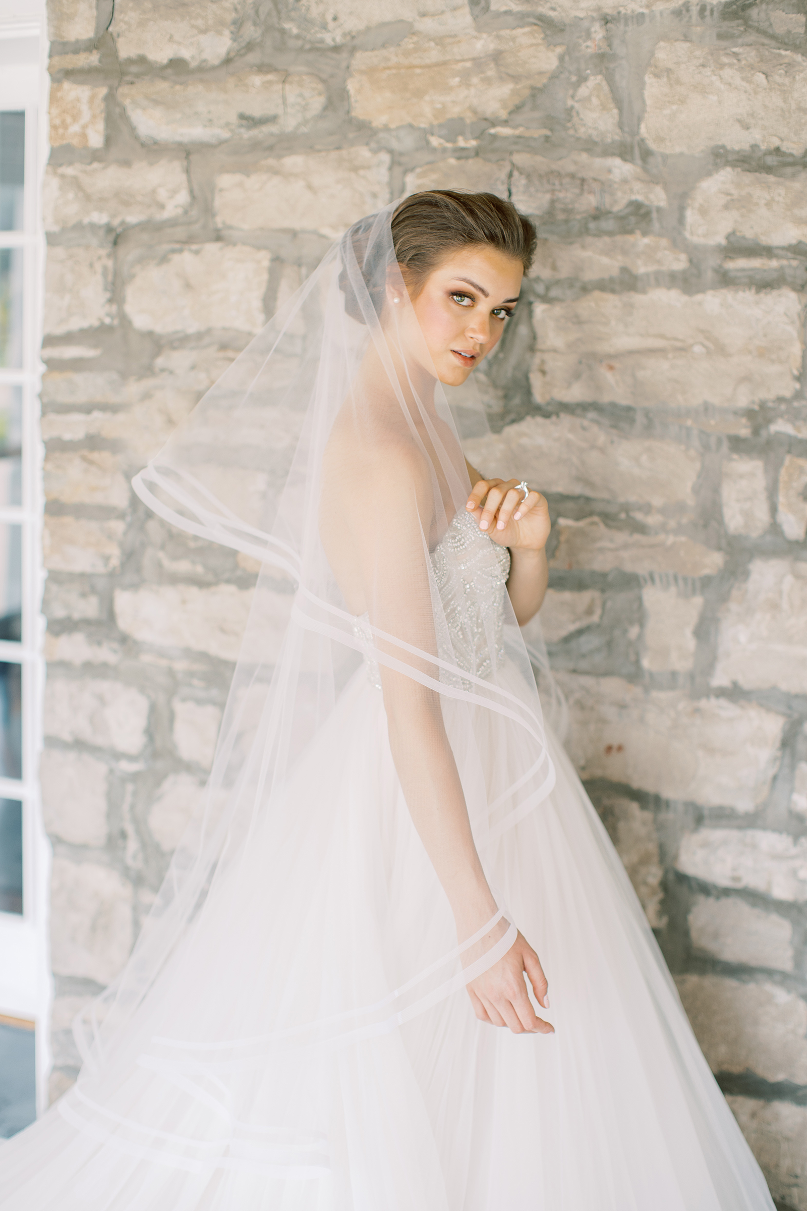 A tiered, waltz length veil, the Tart style is trimmed with a double border of woven horsehair which provides both body and a dramatic aesthetic.