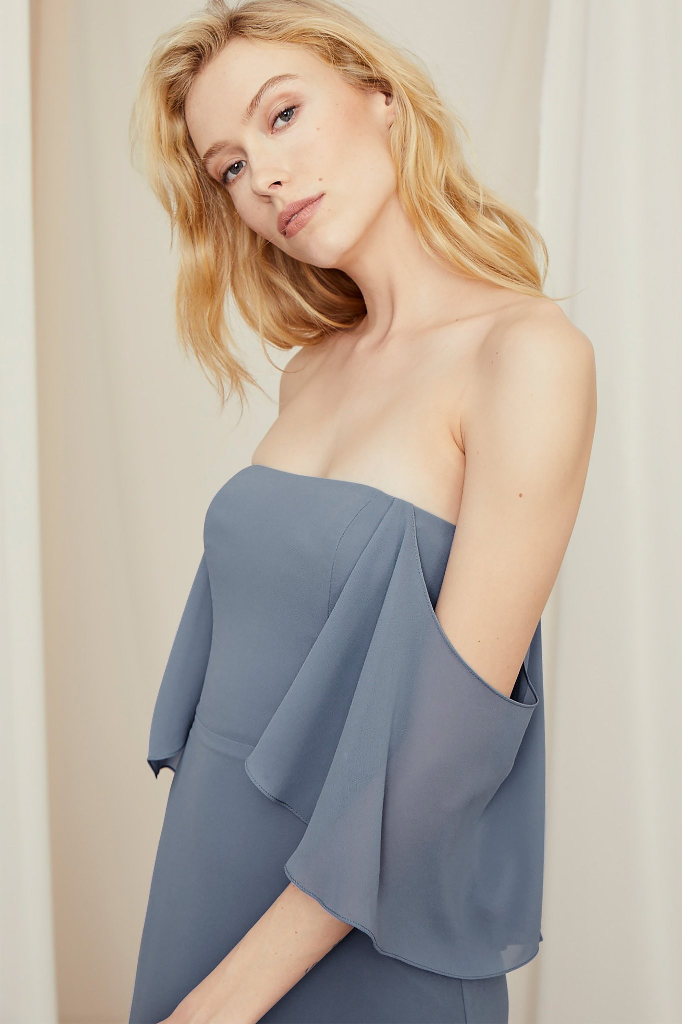 Strapless bridesmaids dress with drape sleeves in chiffon. Shown in Slate.