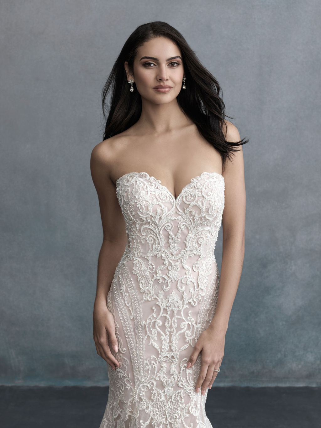 This strapless gown looks incredible on every bride and features a myriad of stunning details that have to be seen to be believed.