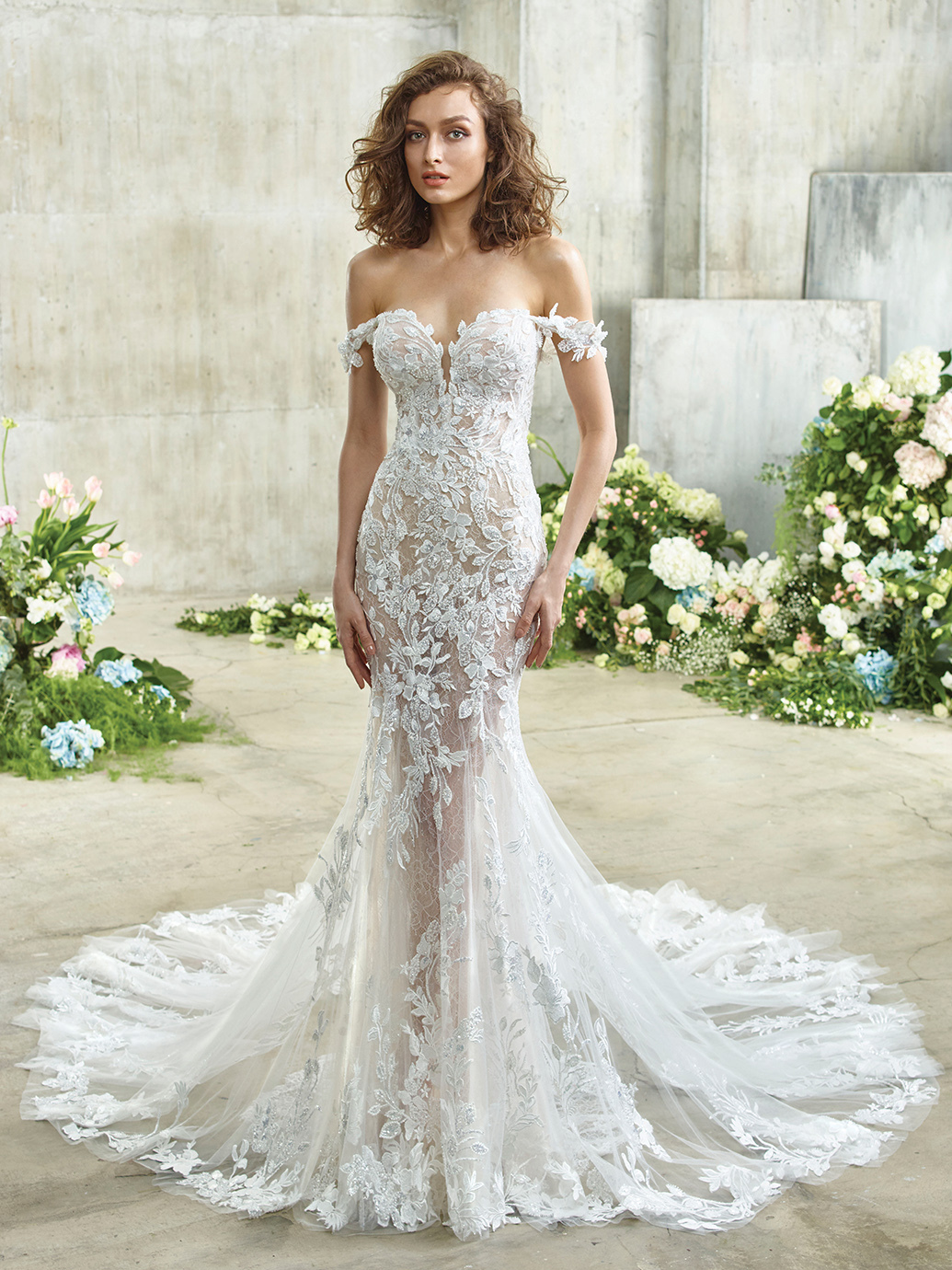 The picture of beauty and romance. Etta features the sweetest off-shoulder beaded floral lace straps that are actually detachable! The most gorgeous blend of beaded floral lace, Chantilly lace, and tulle flows harmoniously throughout the gown all the way down to the stunning train for the dreamiest waterfall effect.