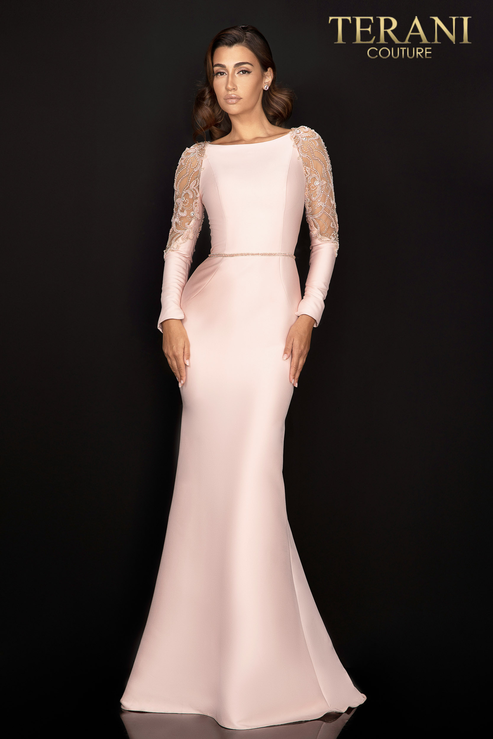 Fitted Stretch Mikado gown has a delicate back and long sleeve beading. Finished with slim skirt and bead defined waist