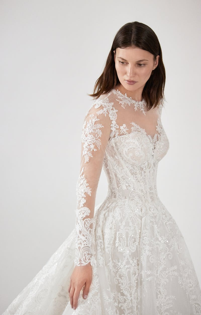 Grand princess ballgown in beaded lace with corset bodice and long sleeve.