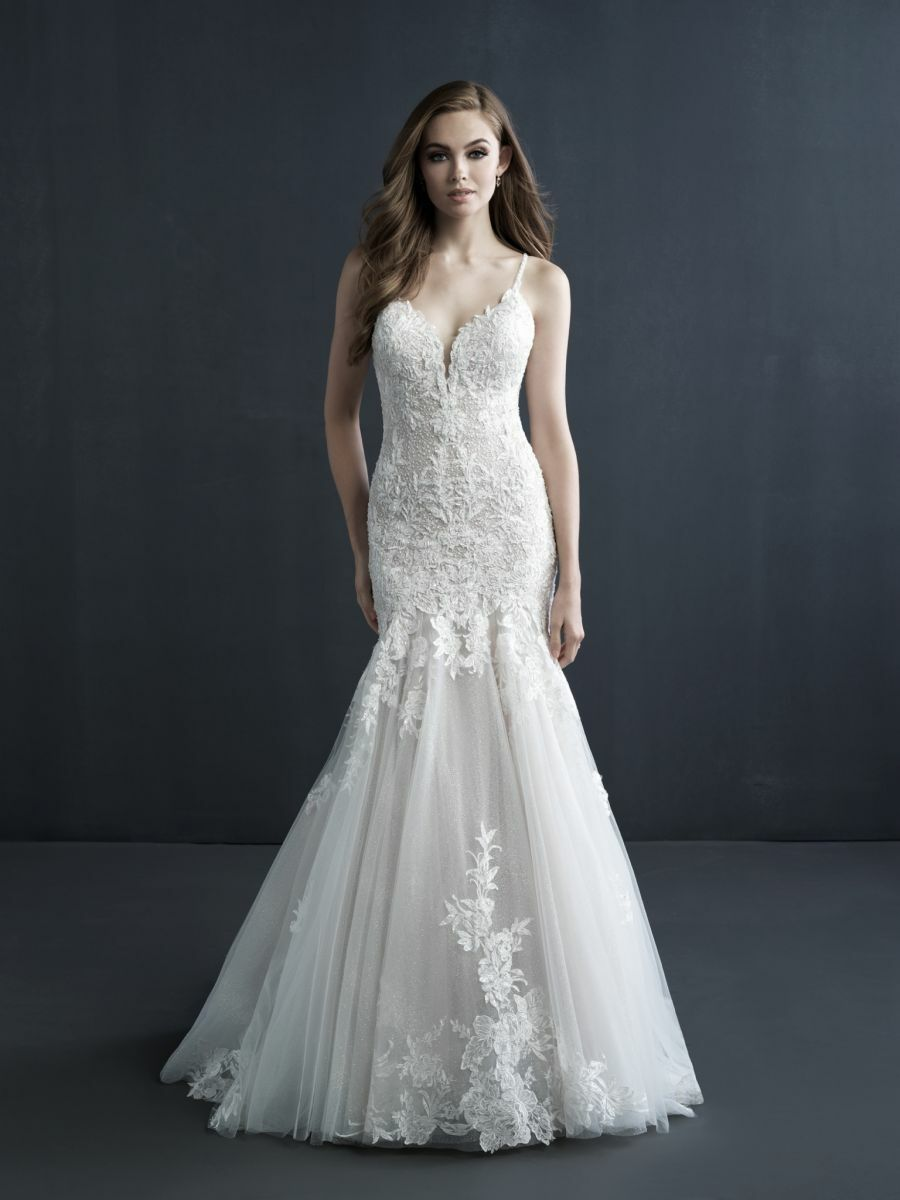 Gorgeous, unique embroidered designs sweep the bodice of this fit and flare gown.