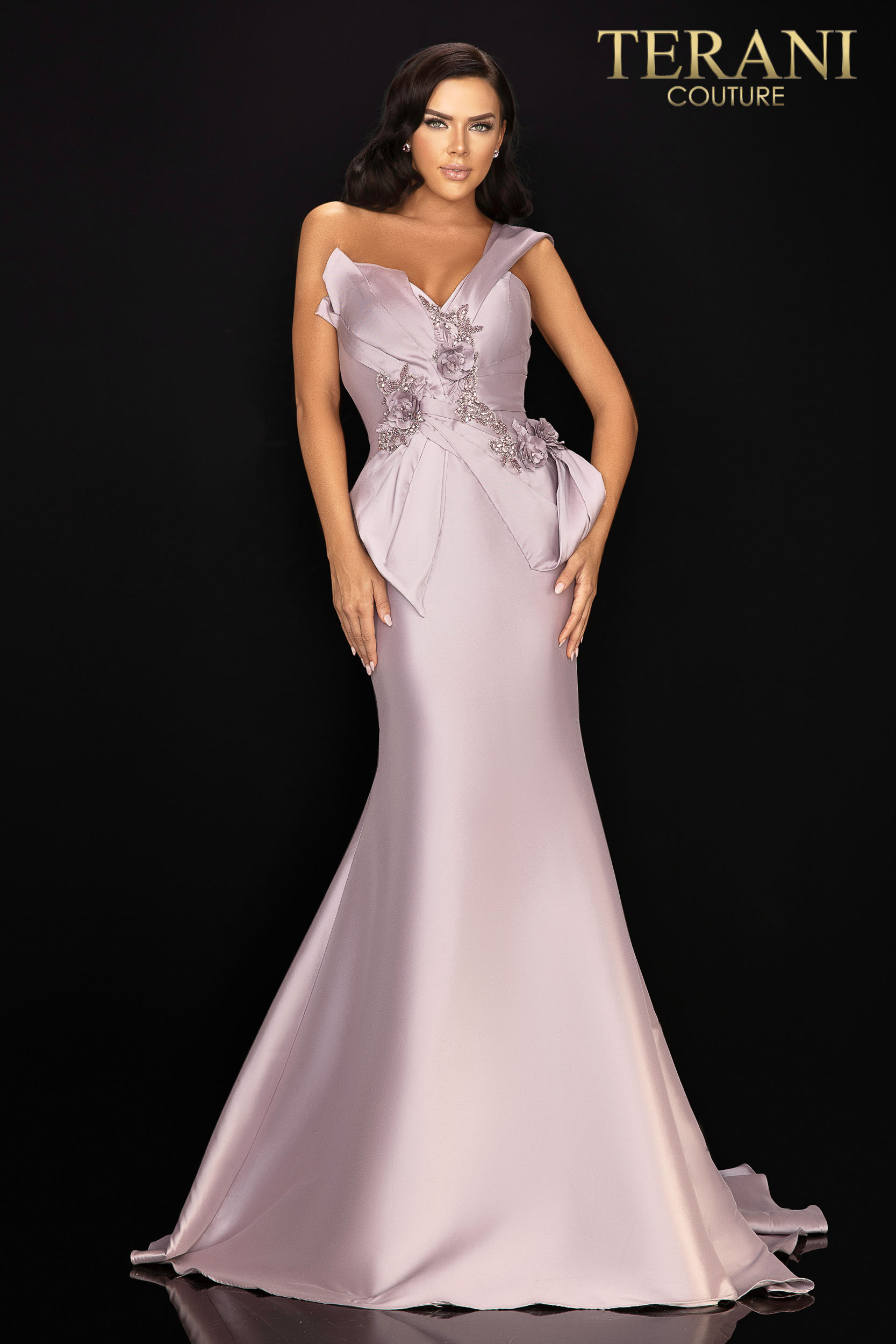 Intricately wrapped stretch Mikado mother of the bride gown held in place with tonal 3D flowers and bead detail. Accented with one off shoulder cuffs.