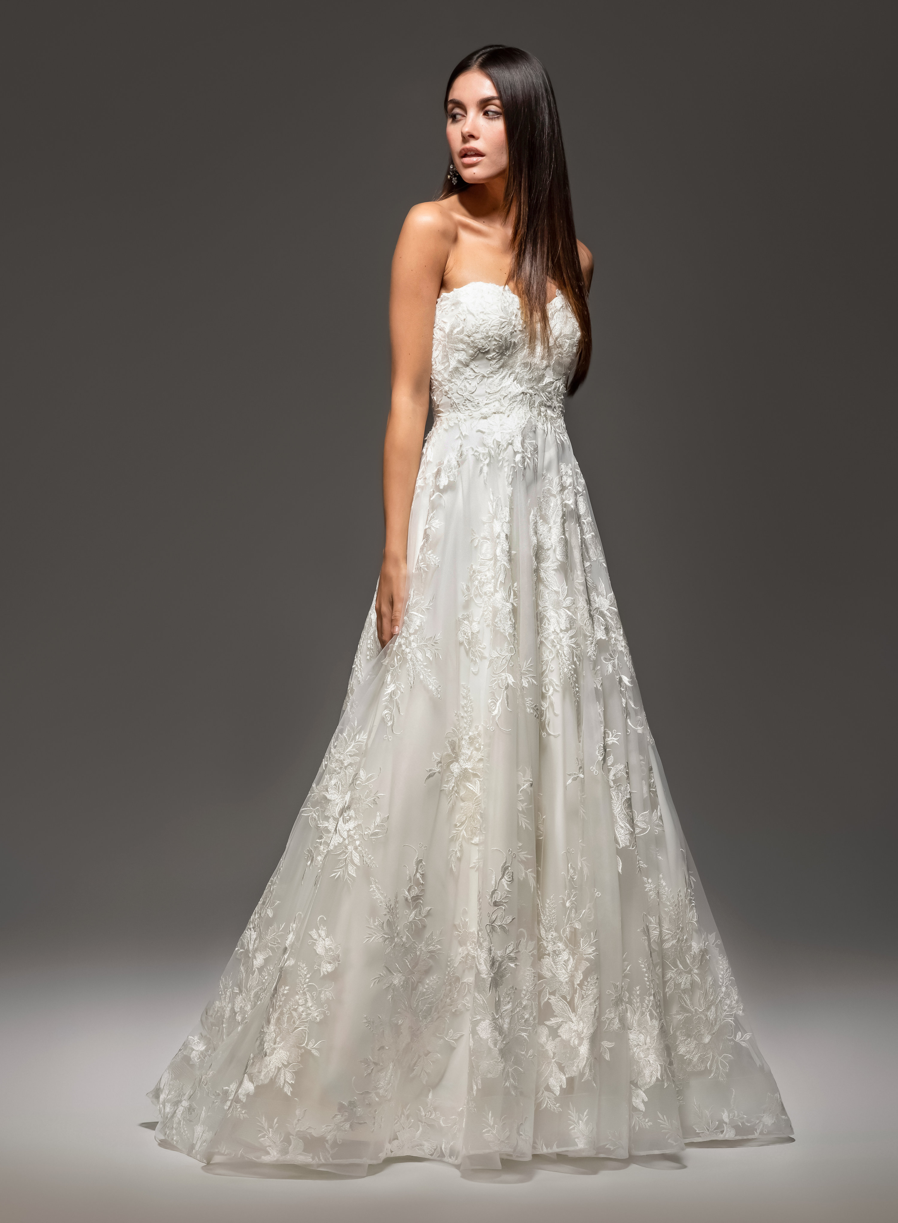 Ivory Alencon lace ball gown, strapless sweetheart neckline, natural waist, chapel train.