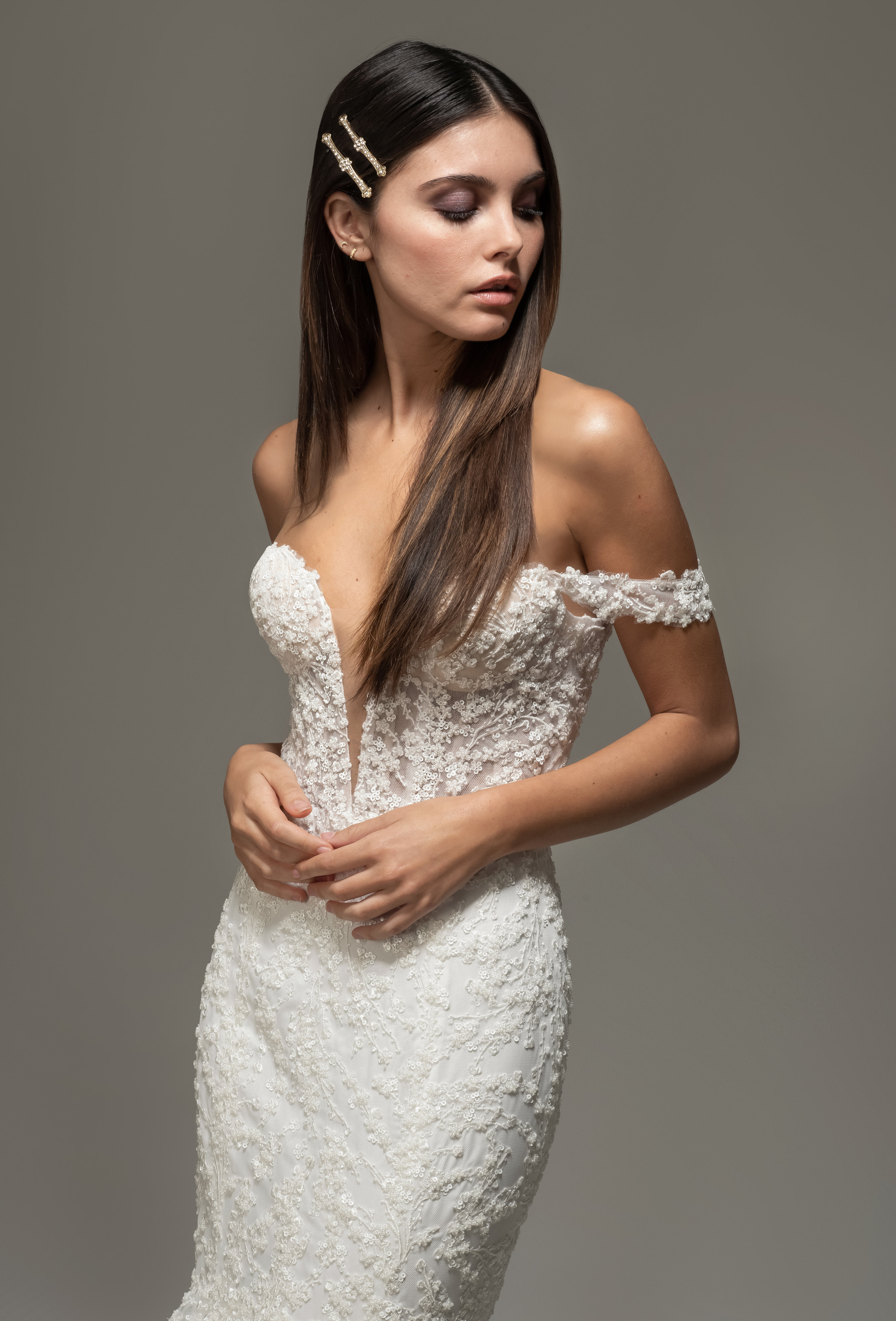 Ivory beaded mermaid gown, deep sweetheart neckline with off the shoulder strap, layered horsehair skirt, chapel train.