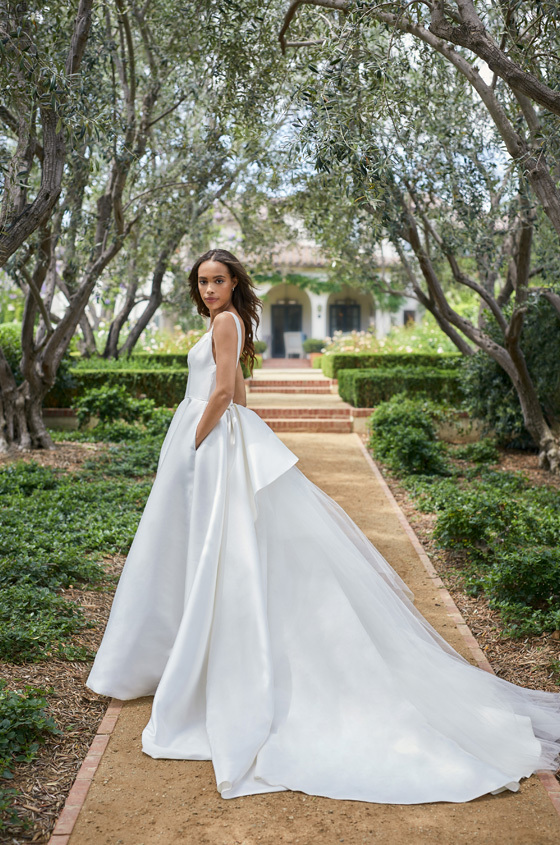 Mikado scoop neck ball gown with low scoop back and detachable train.