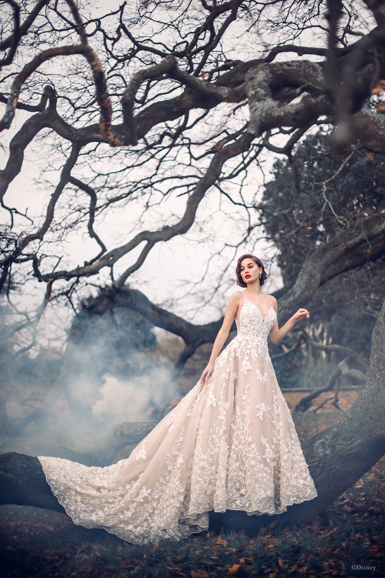 Multidimensional tonal beadwork creates a brilliant and intricate effect across the woodland floral motifs featured in the Snow White-inspired gown. A sparkling layer of tulle ensure this eye-catching gown shimmers at every angle.