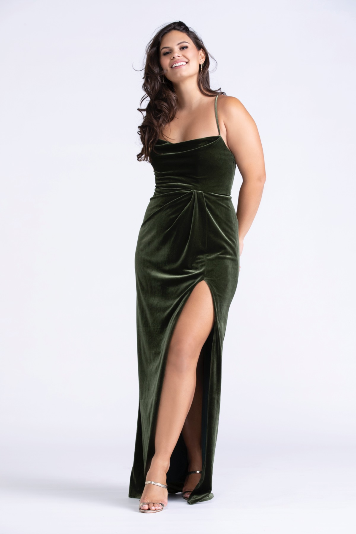 Give your girls the gift of a stretch velvet gown accented with a strappy back. Our vinca stretch velvet is lined in a knit fabric giving the gowns a generous amount of give.