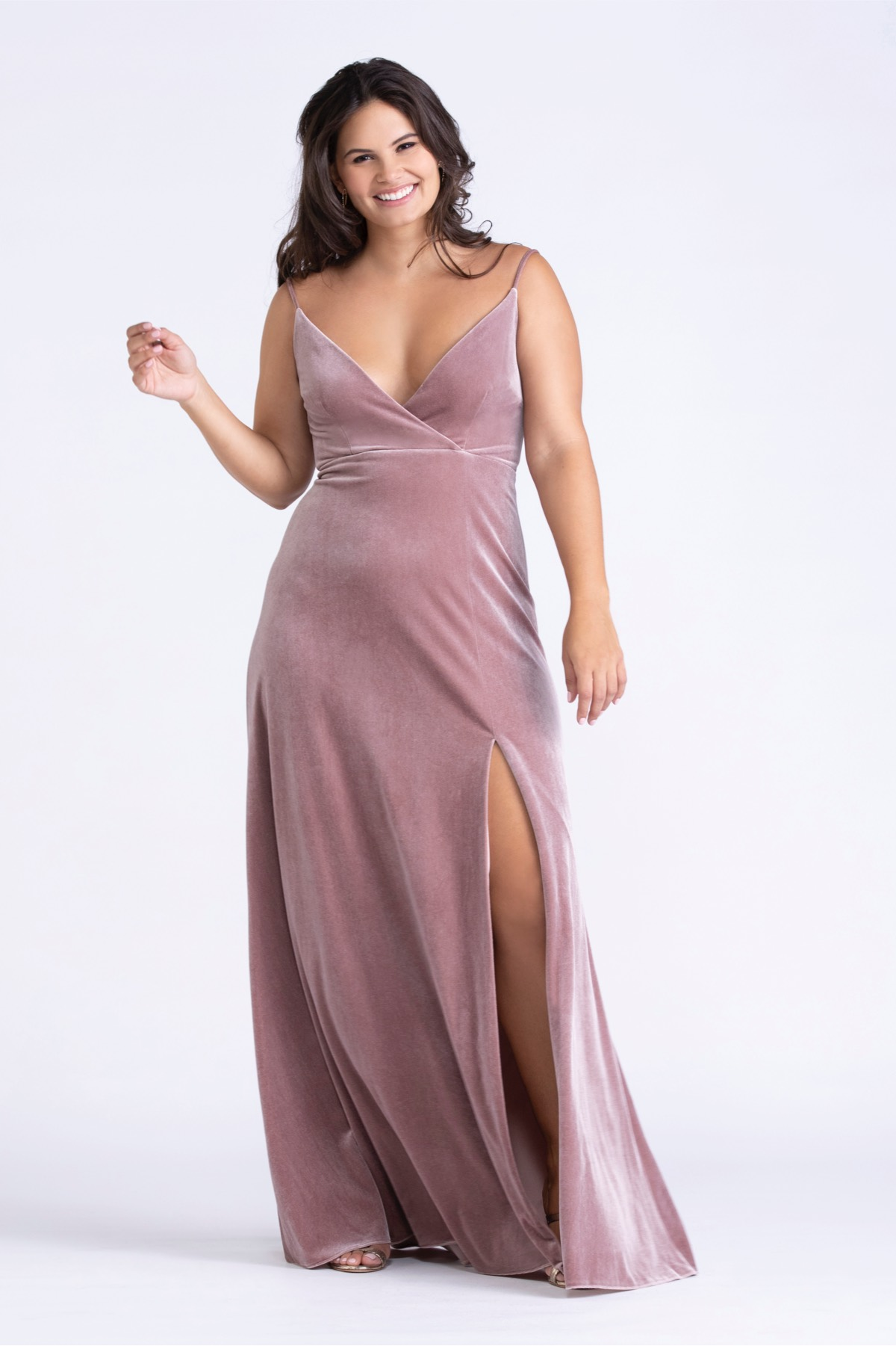 This simple velvet sheath is a classic choice that will be pulled out of the closet again and again. Our vinca stretch velvet is lined in a knit fabric giving the gowns a generous amount of give.