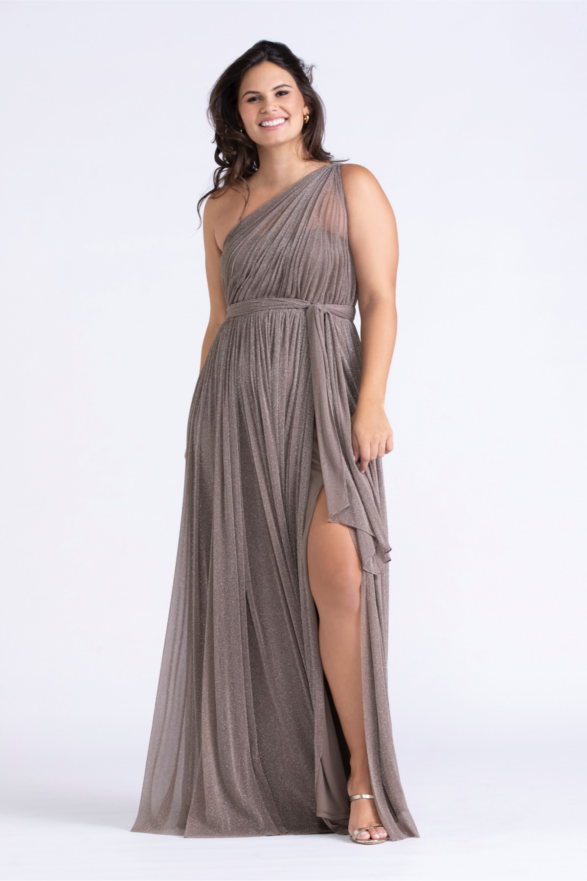 One-shoulder sheath Korby brings the sparkle to the party. Our shimmer mesh is lined in a knit fabric giving the gowns a generous amount of give.