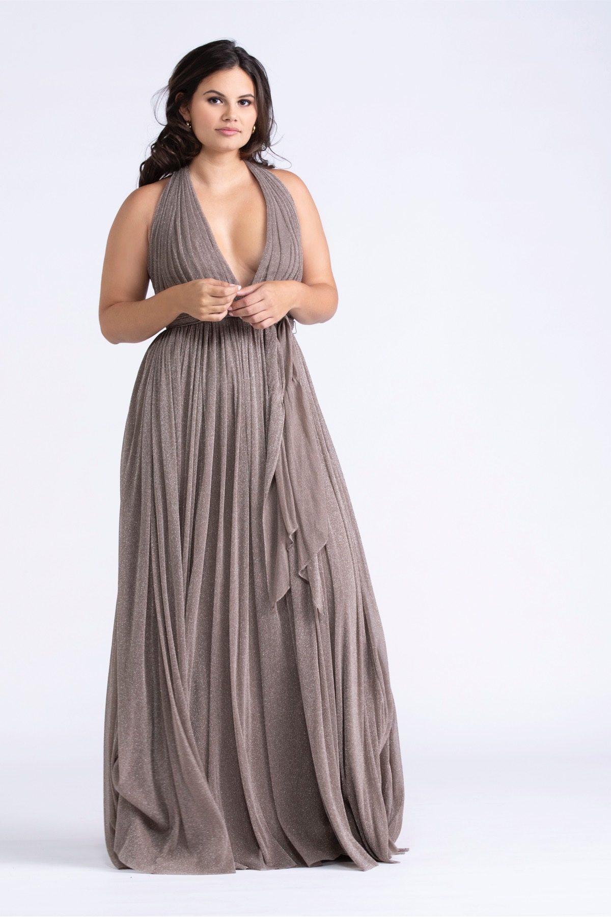 With a deep, plunging V-neck, Madilyn is a no-brainer for your best friends with a bold side. Our shimmer mesh is lined in a knit fabric giving the gowns a generous amount of give.
