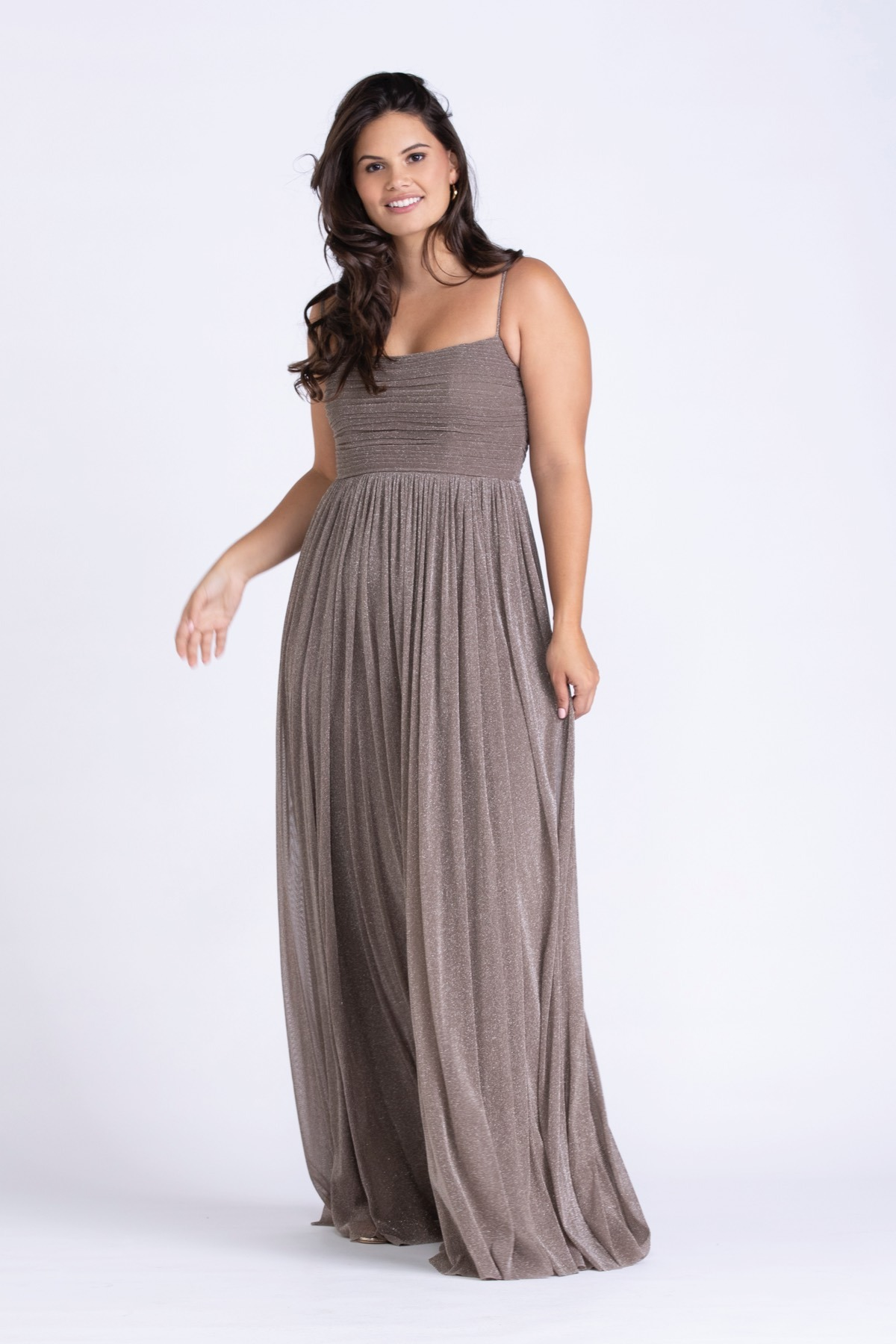 Our Cooper dress, crafted from shimmer mesh, lets every member of your bridal party shine. Our shimmer mesh is lined in a knit fabric giving the gowns a generous amount of give.