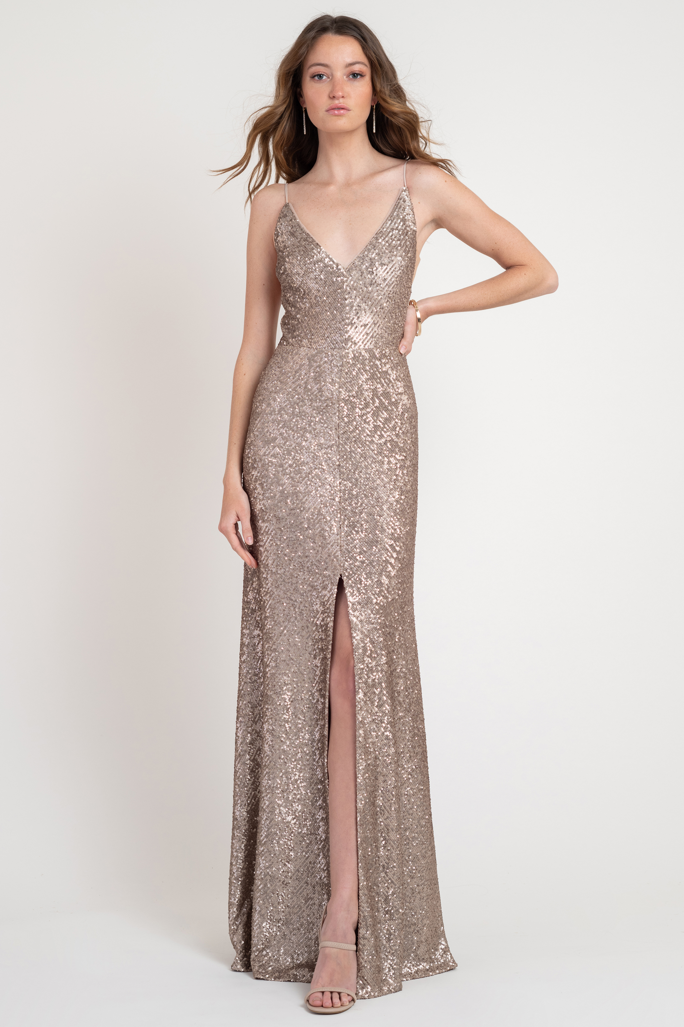 Don't be afraid to go glam in our fully sequin Zelda dress.Slimming illusion sidesand that sexy skirt slit! Details: V neckline Striped Sequin A line Skirt Slit Illusion tulle side gussets slim your sides Full length Fully lined Invisible center back zipper