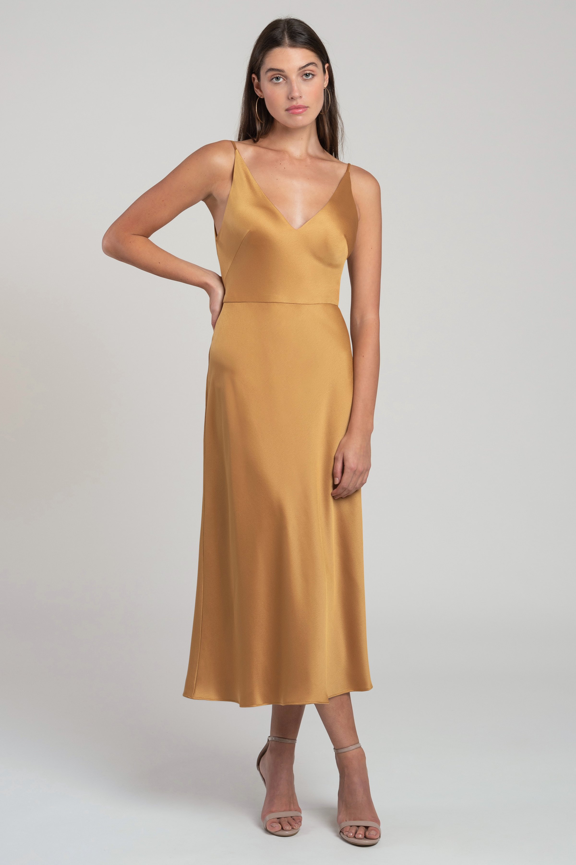 The Marcy V-neck satin midi length bridesmaid dress gives you all of the slinky appeal of a classic sip dress, in an easier to wear silhouette with a natural waist seam. The not-too-low V neckline and body skimming bias cut skirt make this a very flattering style.