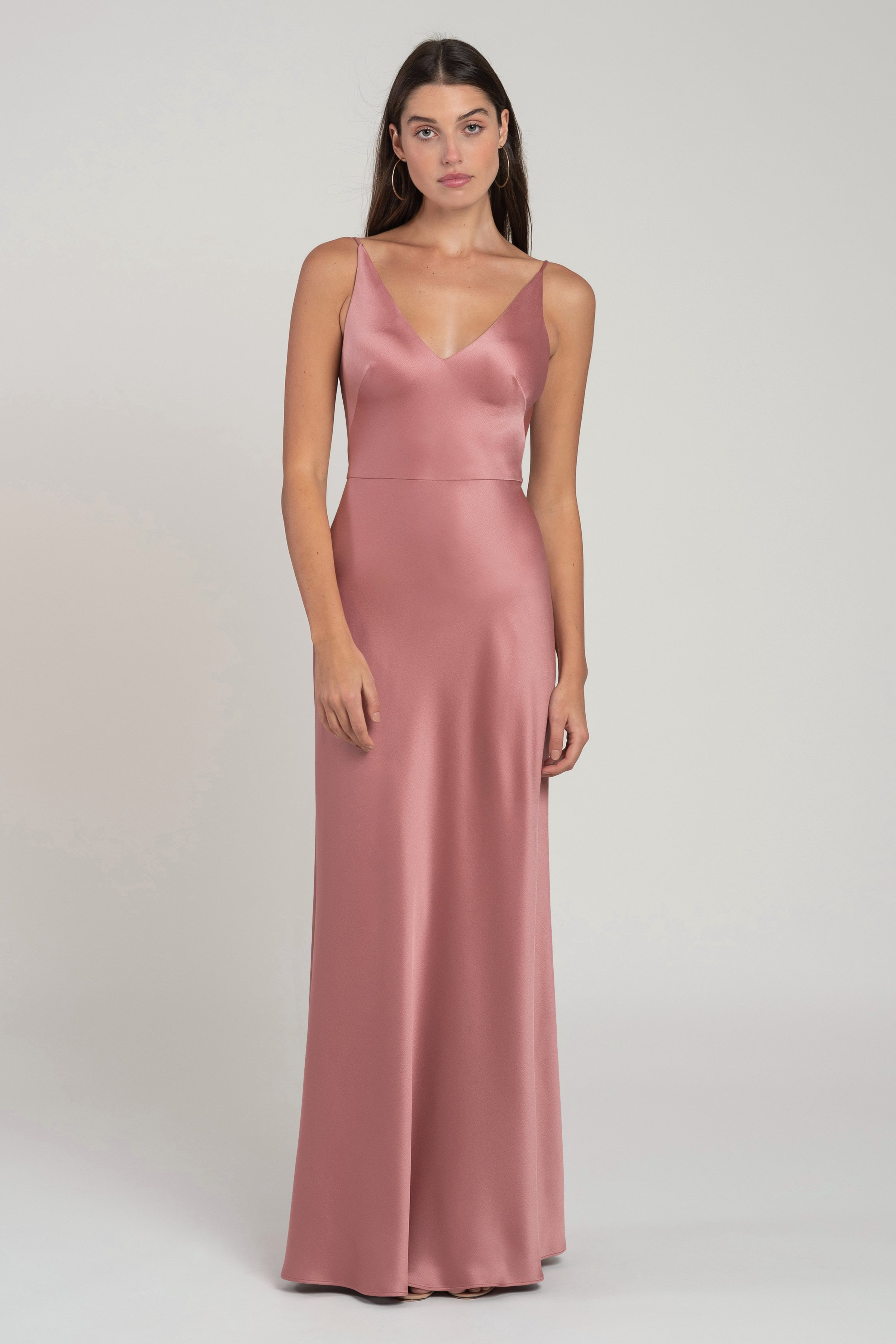 The Marla V-neck satin bridesmaid dress gives you all of the slinky appeal of a classic sip dress, in an easier to wear silhouette with a natural waist seam. The not-too-low V neckline and body skimming bias cut skirt make this a very flattering style.