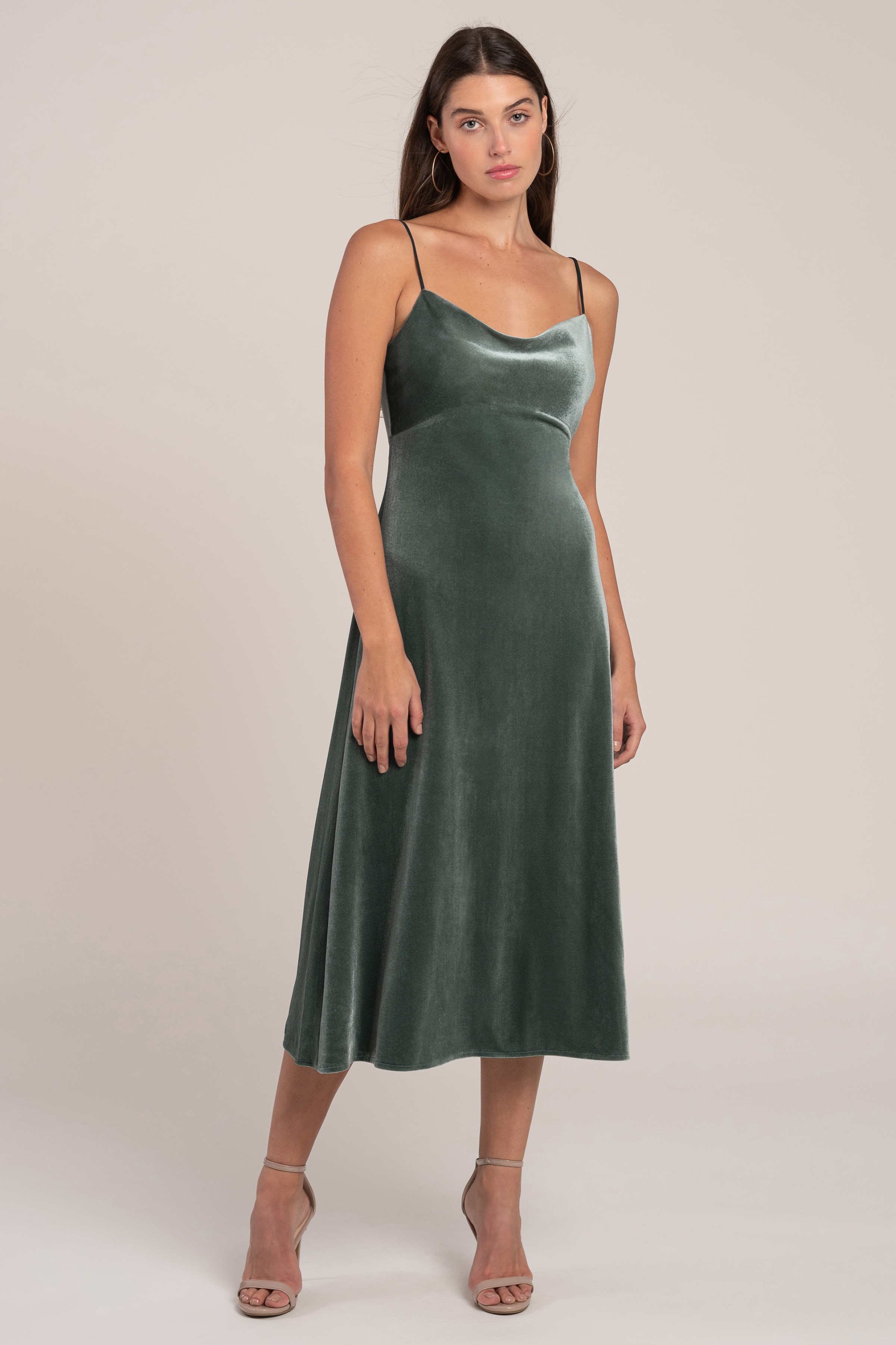 The Saba velvet midi length cowl neck slip bridesmaid dress is an effortlessly glamorous choice for any wedding or event. With the delicate spaghetti straps, gentle cowl neckline, and elongating empire waist seam, this style is incredibly chic and versatile.