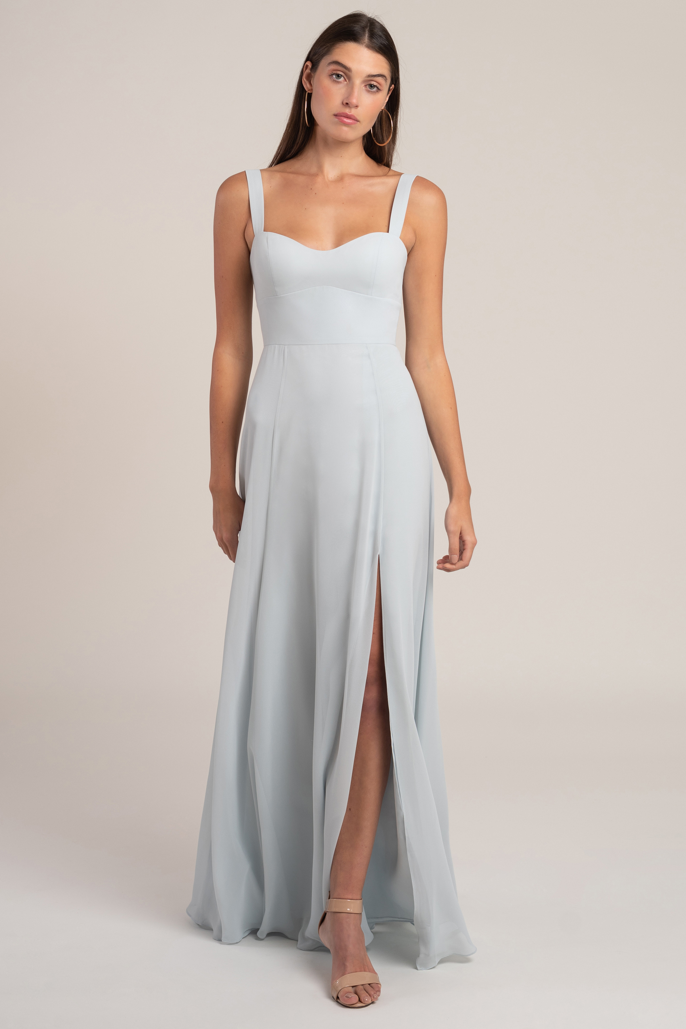 The Harris chiffon bridesmaid dress takes a modern approach to a classic bombshell neckline. The cummerbund detail cinches in your waist, and the flowing chiffon skirt is cut slim through the hips for a beautifully flattering silhouette. With her wide set straps and clean sweetheart neckline, shes sure to flatter every curve.