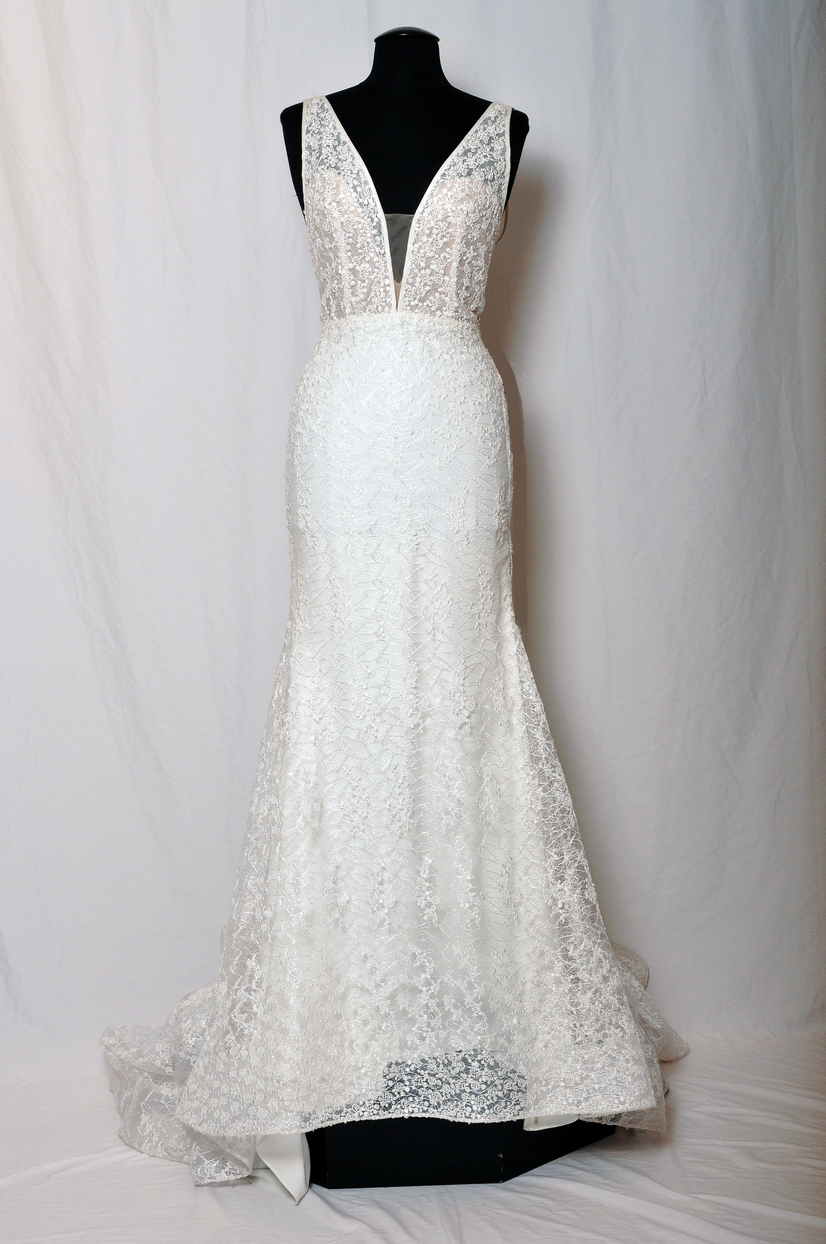 Ivory shimmer lace sheath gown, deep v plunging neckline with nude side cut outs on bodice, nude illusion back v neckline, slim skirt and chapel train.