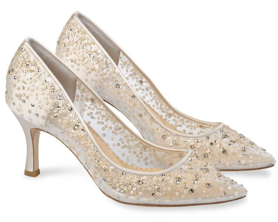 Evelyn bling wedding shoes for brides are from the Bella Belle Euphoria collection. These Cinderella ivory wedding pumps low heel comfortable shoes feature hand-beaded sequin degrade and embellished crystal strass with a beautiful shimmer effect. Evelyn Ivory is a modern take on Cinderella glass slipper wedding shoes.