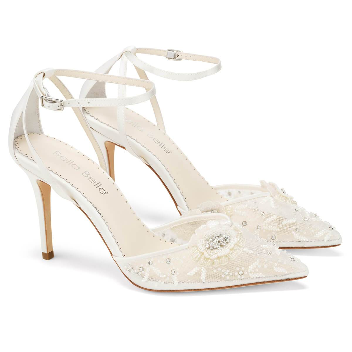 Sequined petals are meticulously stitched together to form two brilliant roses on the toe of Norah, white floral heels. Shimmering beads and sequins catch the light with every glittering step. These ivory flower shoes with ankle strap feature a seductive cutout design at the heel.
