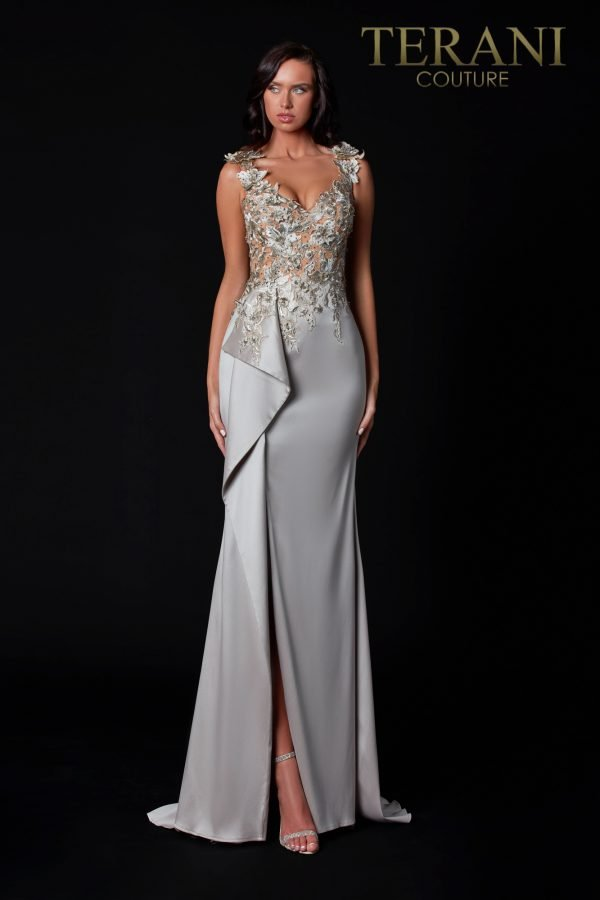 Sheer floral lace on top with a sweetheart neckline on the taupe evening dress and a draped skirt with a front slit to finish it beautifully