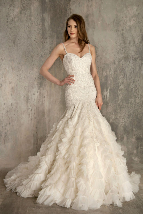 Illusion scoop-neck a-line gown, natural waist, low back, cascading beaded bodice with scattered crystals through skirt