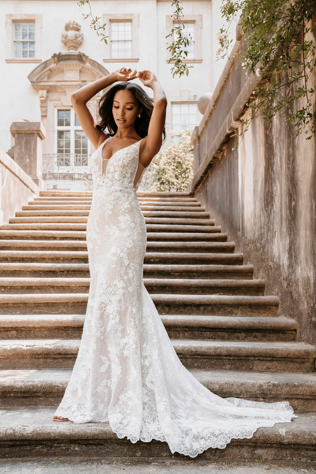 This shimmering sheath gown stands alone and is elevated even further with an airy, detachable train.