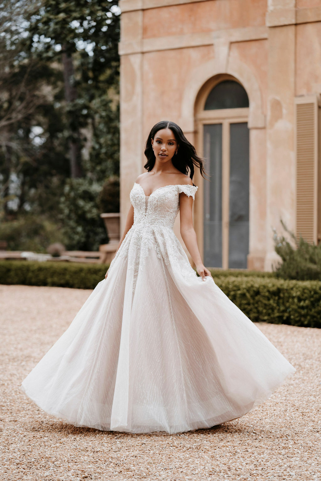 Dazzling beading covers the bodice and off-shoulder cap sleeves of this elegant ballgown.