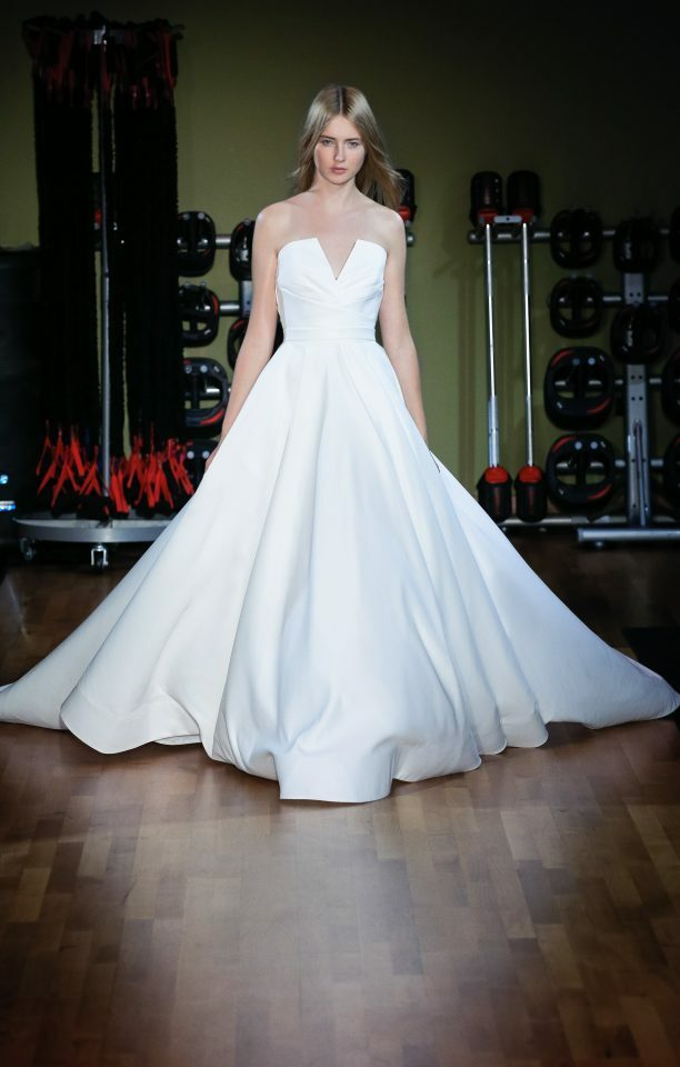 Matte satin ball gown with notched draped bodice.