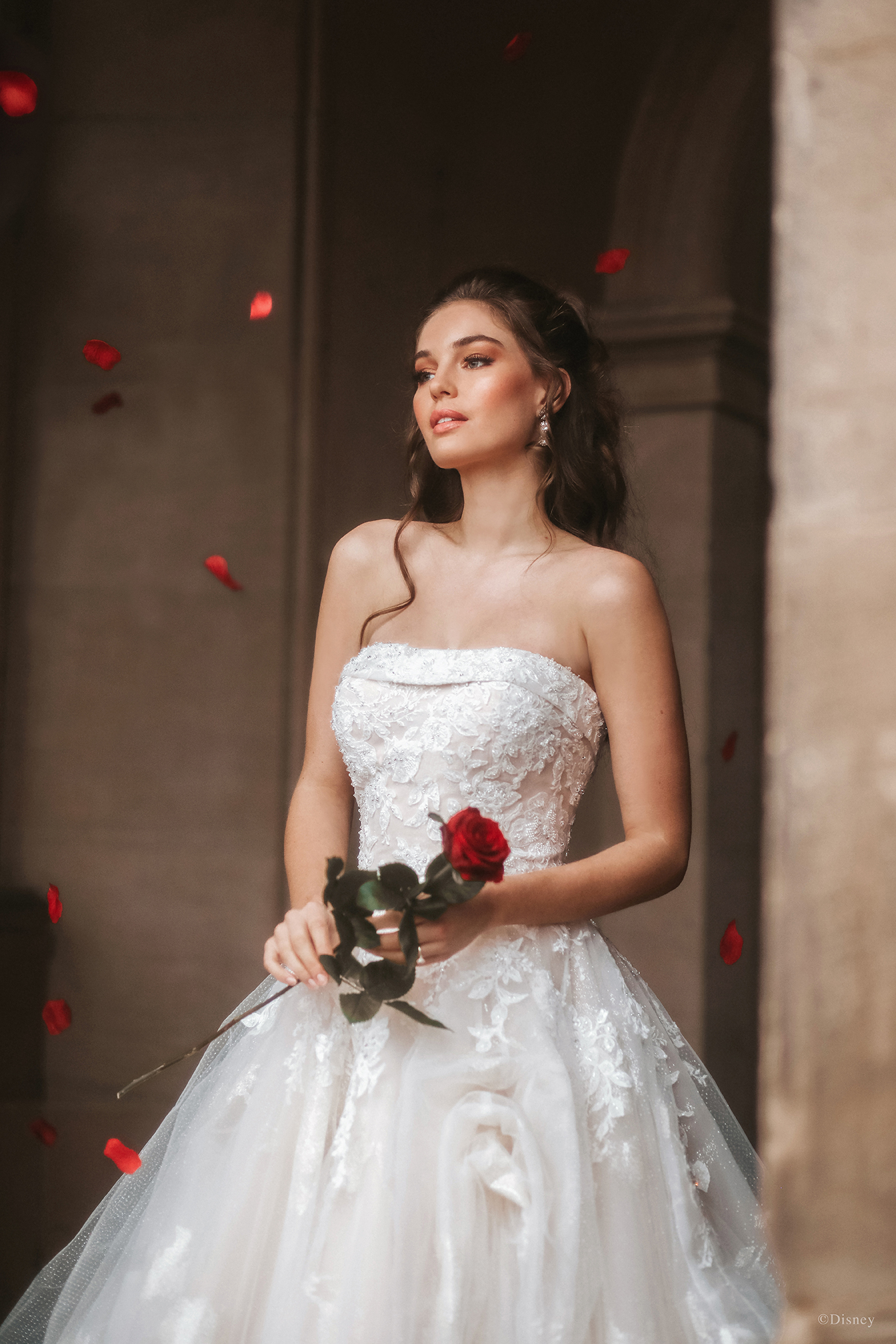 Paying tribute to the 30th anniversary of Disney's 'Beauty and the Beast', we created a ballgown with spectacular shimmering brocade featuring a beautiful rose pattern. Soft pickups across the sparkling tulle overlay lend additional texture and draw design inspiration from Belle's timeless ballgown silhouette.