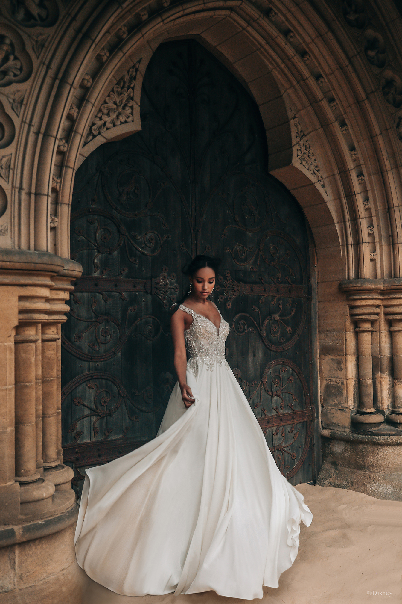 Inspired by Jasmine's adventurous spirit and palatial surroundings, this gown features an intricately beaded bodice, reminiscent of the palace's architecture. The gradual illusion back provides balance to the lightweight 'airy' crepe chiffon skirt, which features hidden pockets!