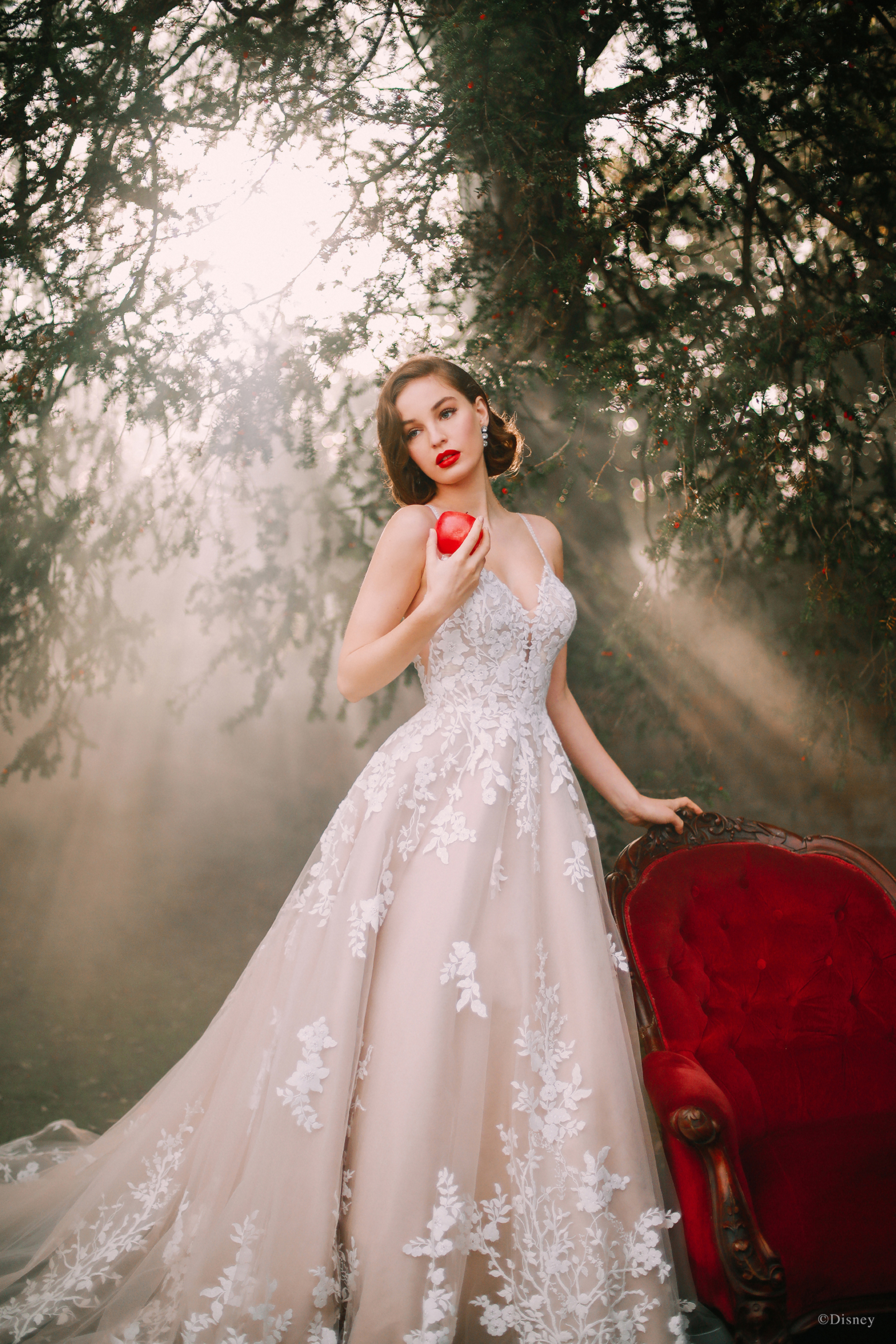 Capturing Snow White's gentle grace and beauty, this classic-inspired ballgown features a bouquet of 'apple' blossoms on the bodice that gracefully cascade down the skirt and cluster at the hemline.