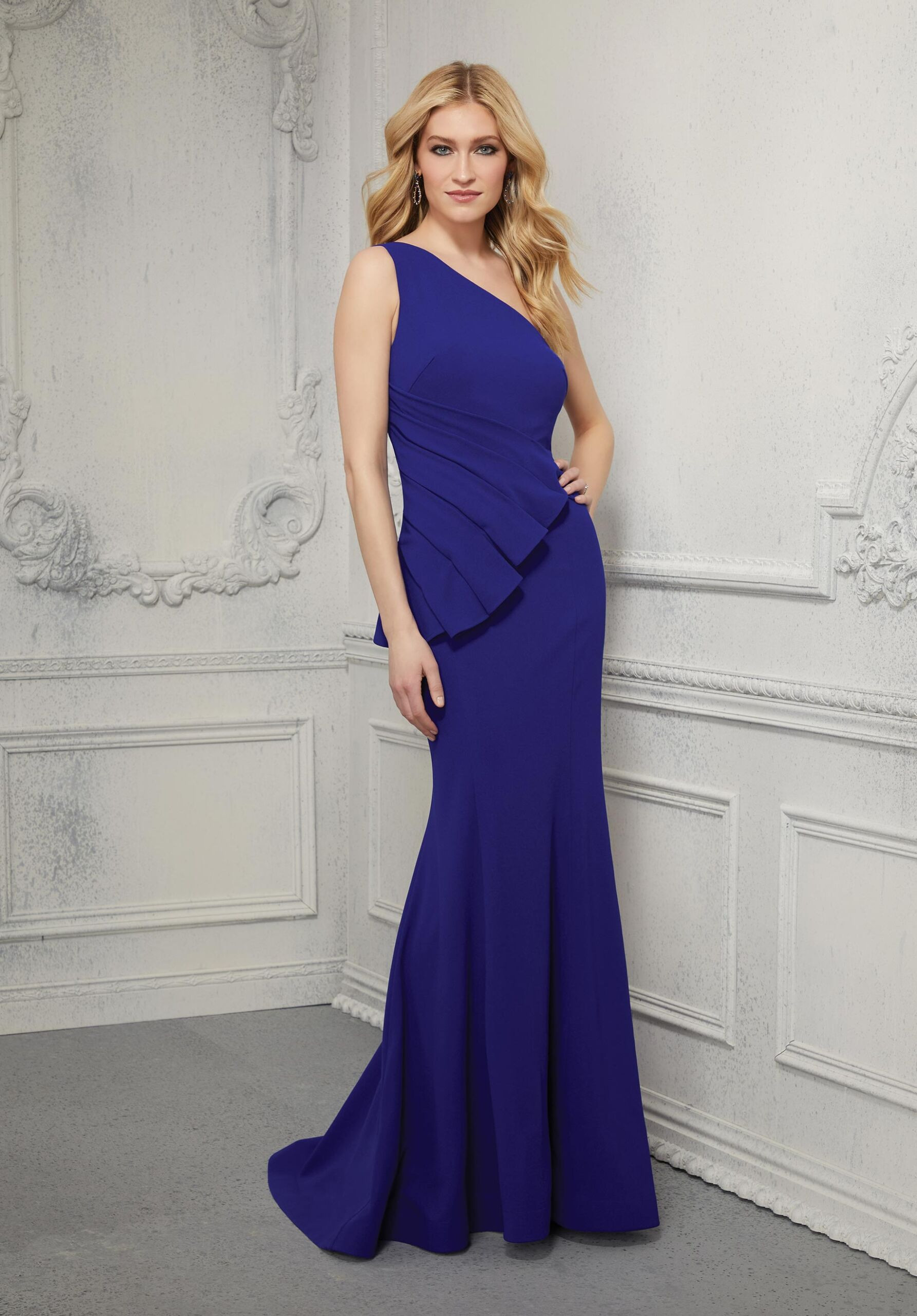 Stylish one-shoulder crepe evening gown with fun ruched waist detail.