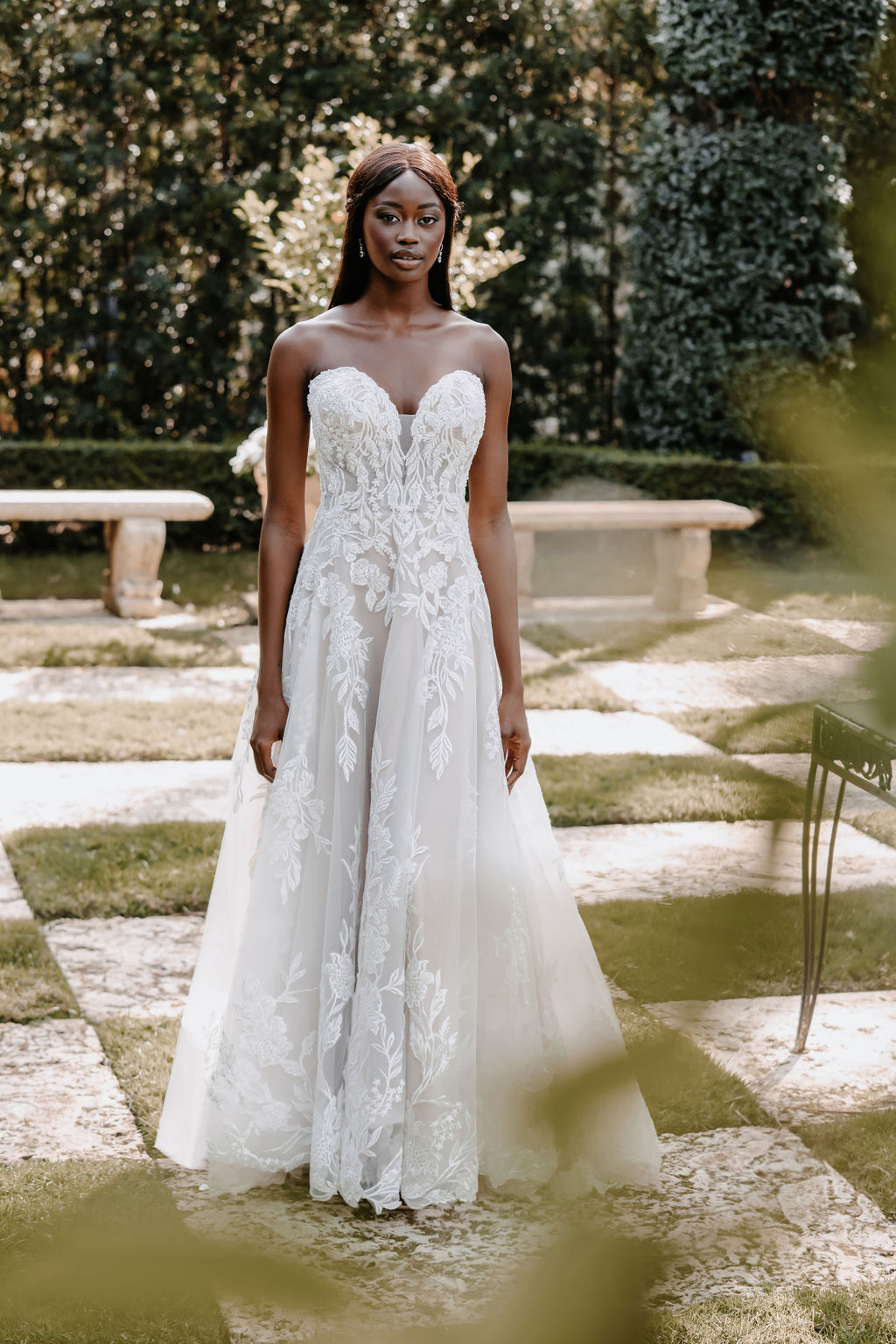 Adorned with mirrored symmetrical beaded appliques, this strapless A-line gown is beautifully unique.
