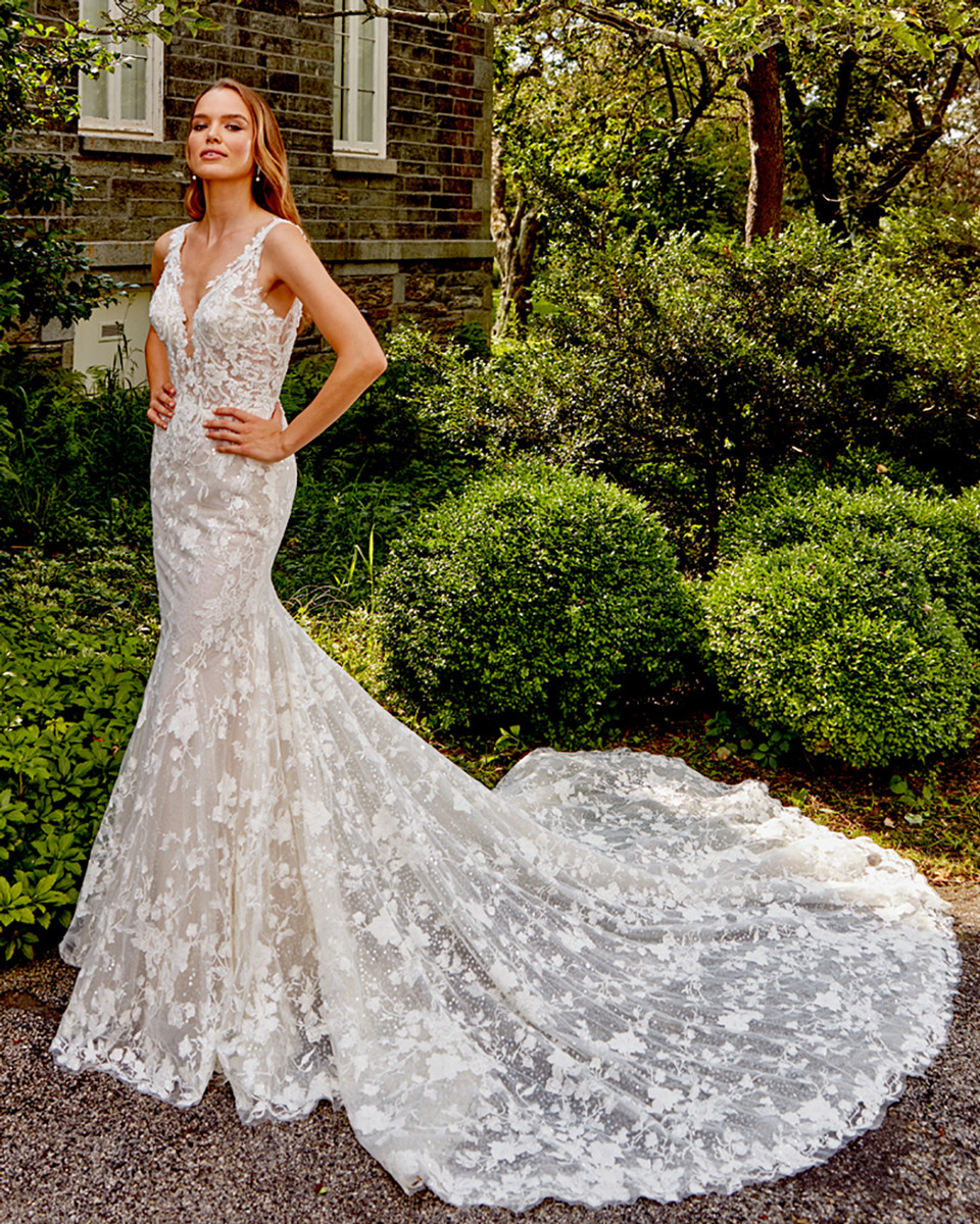 embroidered v neckline with sheer bodice, mermaid with layer of sequin accents underneath, chapel train. Sizes 2-24. Available Colors Ivory/Blush, Ivory, White.