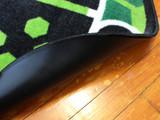 Skid resistant vinyl backing