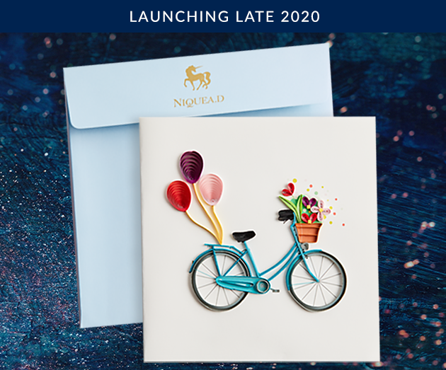 NIQUEA.D Bicycle with Flowers card with aqua colored envelope
