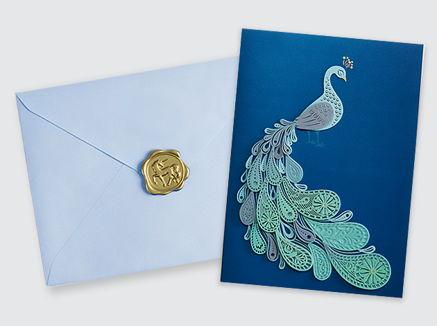 NIQUEA.D Peacock Laser Cut card with light blue envelope and NIQUEA.D gold wax seal