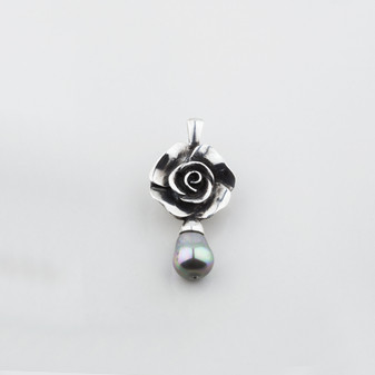 Full-blown flower pendant with a blue shell pearl drop